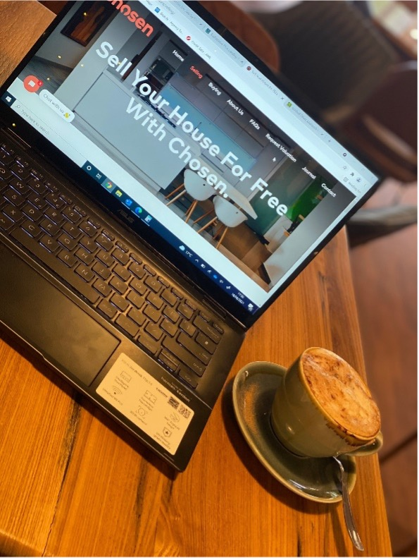 selling property in sutton coldfield laptop on table with coffee at max's coffee shop in sutton coldfield