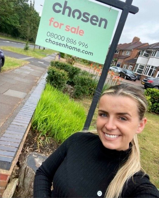 selling property in sutton coldfield hannah in front of chosen for sale board outside home for sale