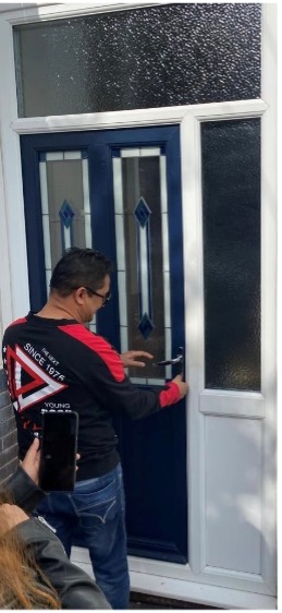 sell house in sutton coldfield buyer putting keys in door of new house